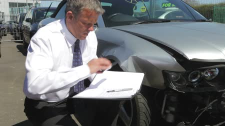 Loss Adjuster Inspecting Car Involved In Accident Stok Video