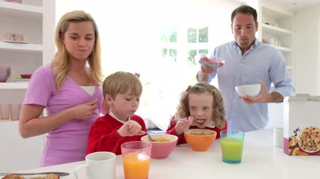 planta de interior : Family Having Breakfast In Kitchen Together Stock Footage