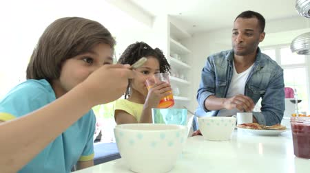 man eating : Family Having Breakfast In Kitchen Together Stock Footage