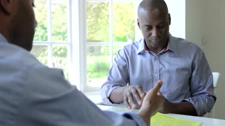 biztosítás : Mature Black Male Meeting With Financial Advisor At Home