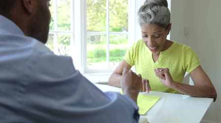 smile : Mature Black Female Meeting With Financial Advisor At Home Stock Footage
