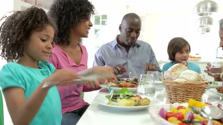 comer : Multi Generation African American Family Eating Meal At Home