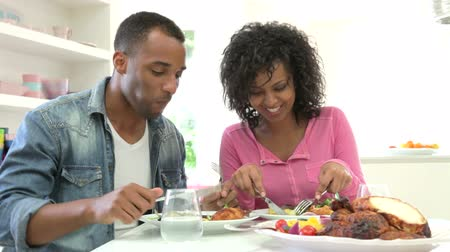 black : Young African American Couple Eating Meal At Home Stock Footage