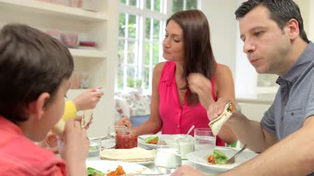 lunch : Hispanic Family Sitting At Table Eating Meal Together Stock Footage