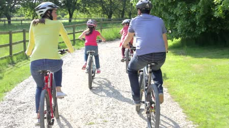 bicycle : Hispanic Family On Cycle Ride In Countryside