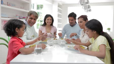 comer : Multi Generation Indian Family Eating Meal At Home