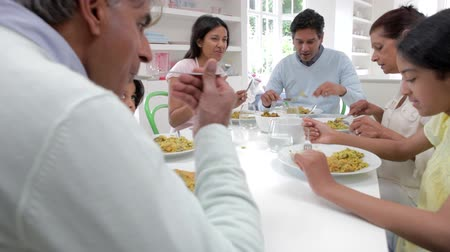 asian family : Multi Generation Indian Family Eating Meal At Home