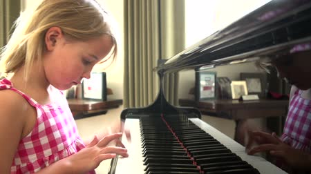 fortepian : Young Girl Practicing Piano At Home