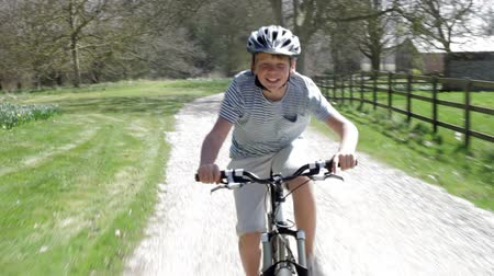 bicycle : Young Boy Riding Bike Along Country Track Stock Footage