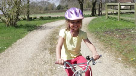 kolo : Young Girl Riding Bike Along Country Track