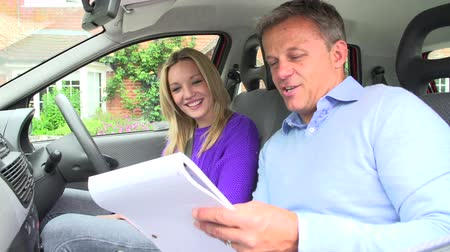 lesson : Teenage Girl Passing Driving Test With Examiner