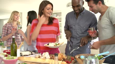 people talking : Group Of Friends Having Dinner Party At Home Stock Footage