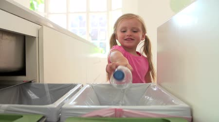 damlatma : Slow Motion Sequence Of Girl Recycling Kitchen Waste In Bin Stok Video