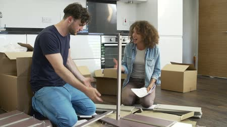 kitchen furniture : Frustrated Couple Putting Together Self Assembly Furniture  Stock Footage