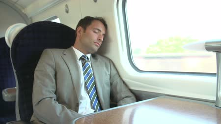 yorgunluk : Businessman Resting On Train Journey Stok Video