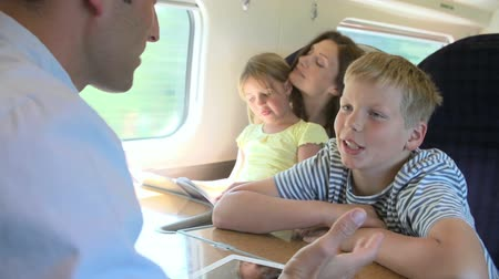 путешествие : Family Relaxing On Train Journey