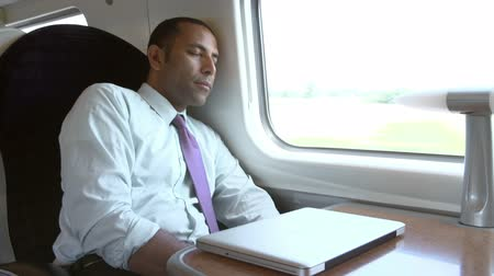 усталый : Businessman Resting On Train Journey Стоковые видеозаписи