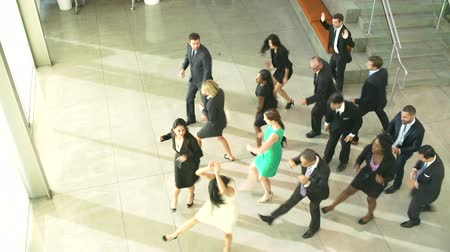 hivatal : Businessmen And Businesswomen Dancing In Office Lobby