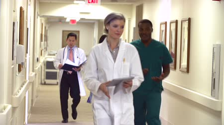Medical Staff Along Hospital Corridor