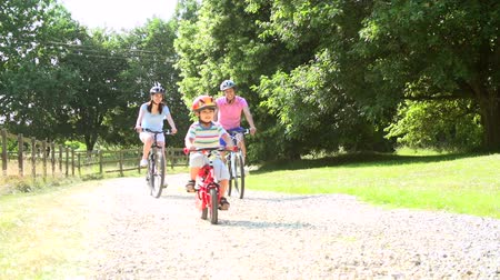 asian family : Asian Family On Cycle Ride In Countryside Stock Footage
