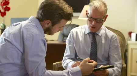 Man Talking To Financial Advisor In Office