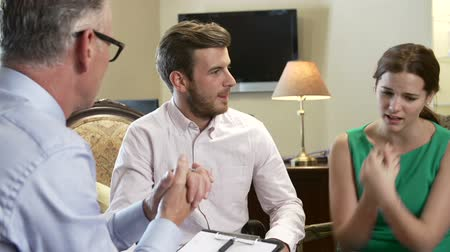 counselling : Young Couple Talking To Male Counsellor Stock Footage
