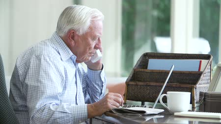 senior lifestyle : Senior Man Finding Phone Number Of Company Online