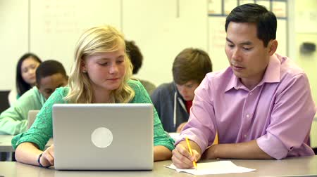 studenci : Female High School Student With Teacher Using Laptop