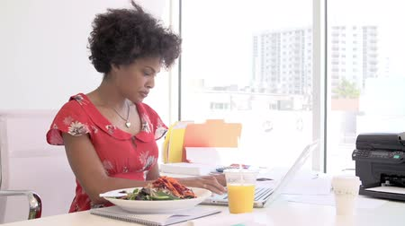 salad : Woman Working In Design Studio Having Lunch At Desk Stock Footage