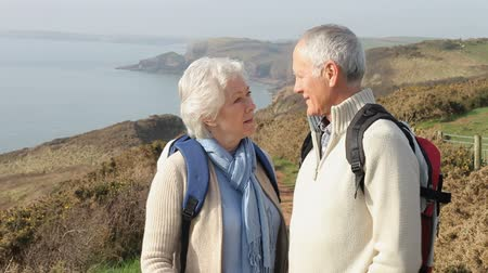 emekli : Senior Couple Taking Selfie Walking Along Coastal Path