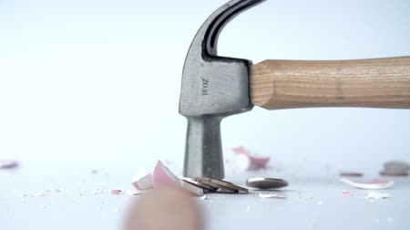 bringing home the bacon : Hammer Smashing Piggy Bank In Slow Motion