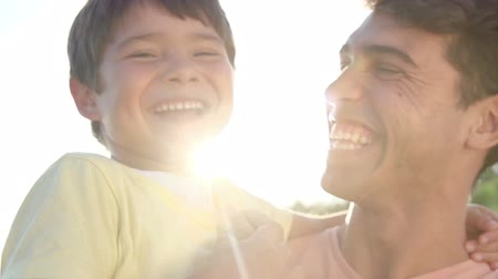 apa : Portrait Of Hispanic Father And Son In Slow Motion