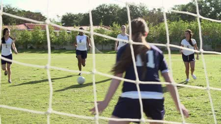 piłka nożna : Slow Motion Sequence Of Female High School Soccer Team Match Wideo