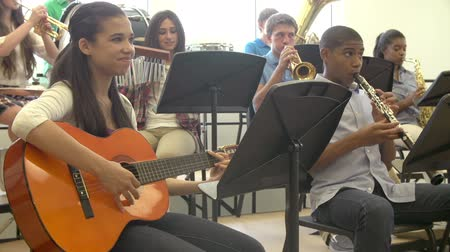 lesson : Pupils Playing Musical Instruments In School Orchestra