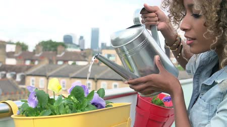 self sufficiency : Woman Watering Plants Outdoors In Slow Motion