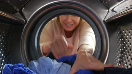 çamaşırhane : Woman Taking Laundry Out Of Washing Machine