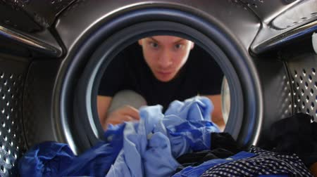 roupas : Man Taking Laundry Out Of Washing Machine