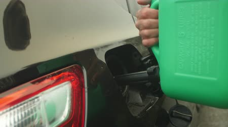 pour out : Driver Refilling Fuel Tank After Running Out Of Petrol