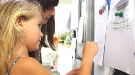 onto : Mother And Daughter Putting Star On Reward Chart Stock Footage