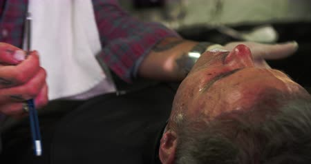 barbear : Barber Shaving Client With Cut Throat Razor