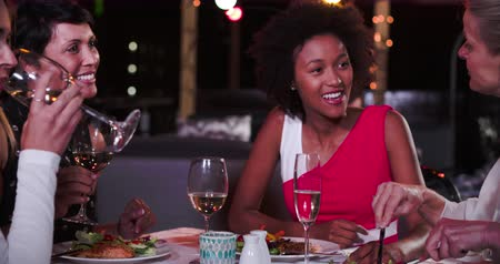 razem : Group Of Female Friends Enjoying Meal At Rooftop Restaurant Wideo