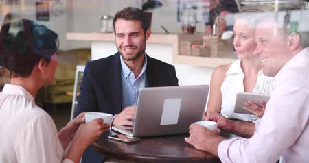 discussion meeting : Business meeting in a cafe Stock Footage