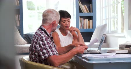 elliler : Worried Mature Couple In Home Office Looking At Paperwork Stok Video