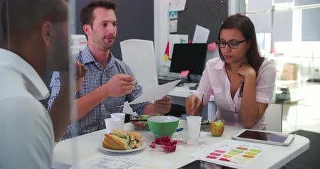 lunch : Businessmen And Businesswoman Having Working Lunch In Office Stock Footage