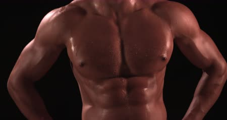 kaslı : Bare chested male body builder with hands on hips Stok Video