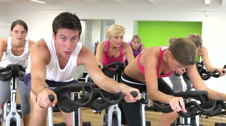 sınıf : Group Taking Part In Spinning Class In Gym