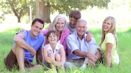 elliler : Multi-Generation Family Sitting In Field Together