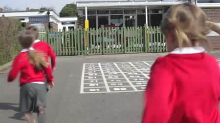 alapfokú : Elementary School Pupils Running Out Of Playground