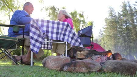 elliler : Senior Couple Enjoying Meal On Camping Holiday