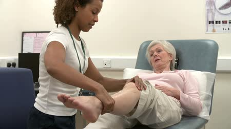 Senior Female Patient Having Physiotherapy In Hospital Stok Video